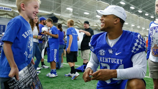 Triston Boyd, 7, of Stanford, Ky talks with UK linebacker Jordan Jones during UK Football Fan Day in Lexington, Ky., on Saturday, August 5, 2017.