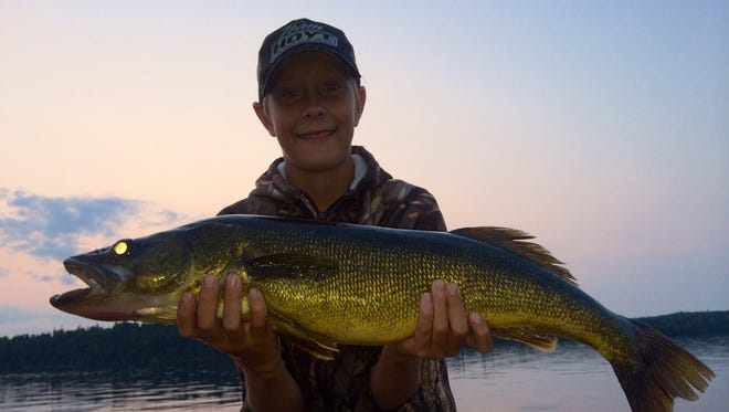 John Nickel, 10, of Suamico, caught and released this walleye in July 2014 during a father-and-son fishing trip to Rocky Shore Lodge in Perrault Falls, Ontario.