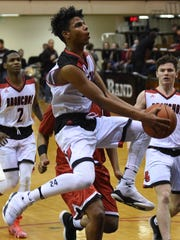 Ziare Williams flies to the basket for the Bronchos