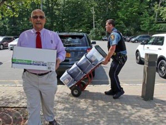 Town Clerk Christian G. Sampson brings in more than