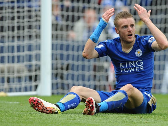 Leicester City's Jamie Vardy reacts to being shown a second yellow card and sent off during the English Premier League soccer match between Leicester City and West Ham United at the King Power Stadium in Leicester, England, Sunday, April 17, 2016. (AP Photo/Rui Vieira)
