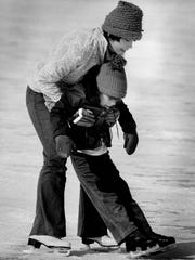 Nancy Curtis helps Trent Culbertson get ready to ice skate at Cobbs Hill Park. Trent — who was 5 years old in this 1979 photo, was ice skating for the first time.