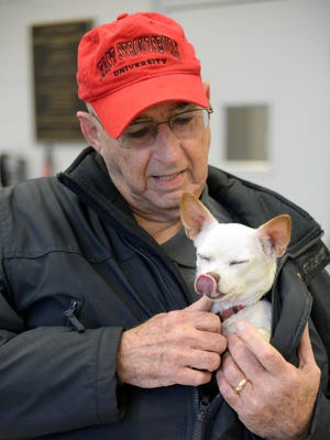 Rich Quay of Vineland attends a 2015 Vinealnd rabies clinic with his Chihuahua, Maxi.