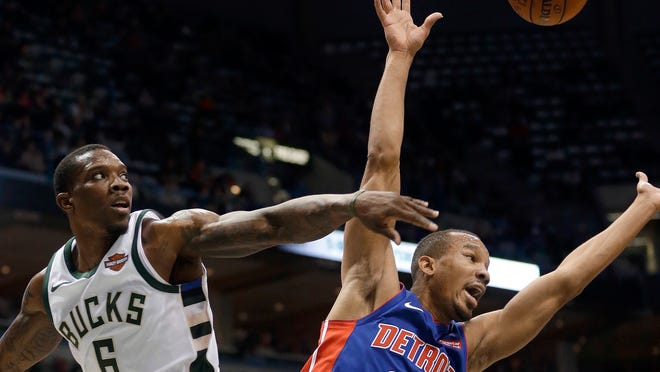 Avery Bradley is blocked by the Bucks' Eric Bledsoe during the first half Wednesday.
