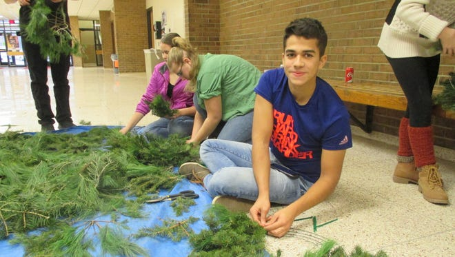 Igor Leal and a dozen other Spencer-Van Etten High School students learned how to make wreaths on Community Service Day this past Friday. Igor is from Brazil and is one of S-VE's foreign-exchange students. He said he likes everything about the way Americans celebrate Christmas.