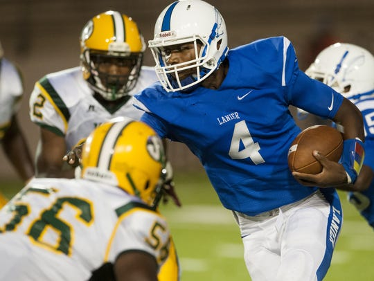 Lanier quarterback James Foster (4) carries against