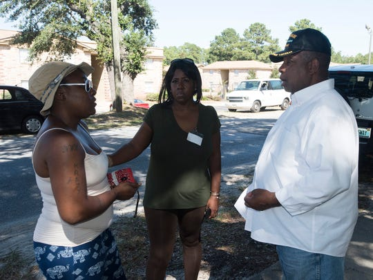 Forest Creek Apartments resident Kodesh Haynes, left,
