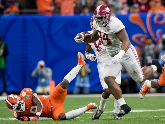 Alabama defensive lineman Da'Ron Payne (94) returns an interception against Clemson in the Sugar Bowl at the Superdome in New Orleans, La. on Monday January 1, 2018. (Mickey Welsh / Montgomery Advertiser)