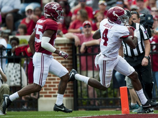 Alabama wide receiver Jerry Jeudy (4) scores against Alabama defensive back Xavier McKinney (25) during the A-Day scrimmage game at Bryant Denny Stadium in Tuscaloosa, Ala., on Saturday April 22, 2017.