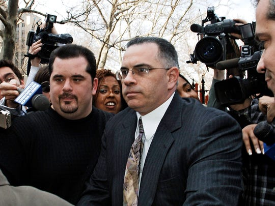 John Gotti Jr. exits Manhattan federal court with his brother Peter (left) by his side on March 10, 2006, in New York.