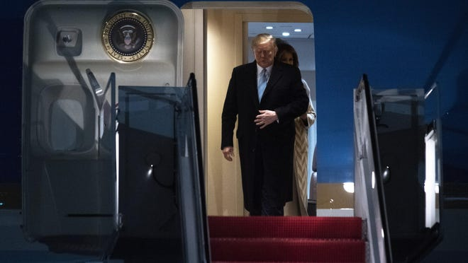 President Donald Trump and first lady Melania Trump exit Air Force One, Sunday, Jan. 5, 2020, at Andrews Air Force Base, Md., following a trip to his Mar-a-Lago estate.