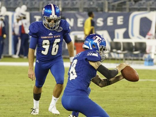 Tennessee State's Austin Rowley (48) prepares to hold on a field goal attempt by Coby Weiss (96), who replaced Lane Clark, in Saturday's game against Austin Peay. Clark was sidelined with a leg injury.