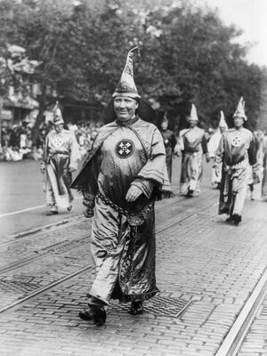 """Dr. H.W. Evans, Imperial Wizard of the Ku Klux Klan, leads his Knights of the Klan in a 1926 parade in Washington, D.C. """"The KKK was founded as an anti-Republican organization, not an anti-black organization,"""" state Sen. Patrick Colbeck wrote as part of his proposed revision to social studies standards for K-12 students."""