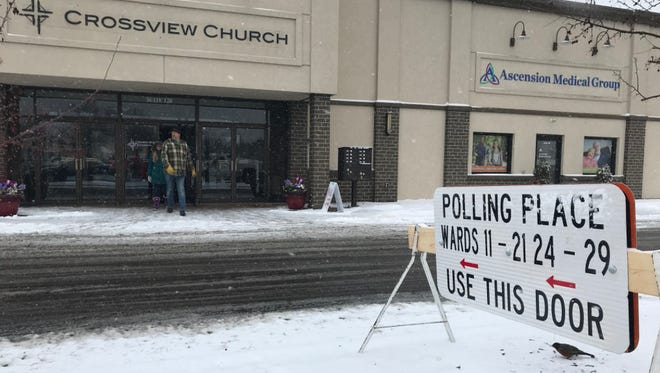 A voter leaves a Wisconsin Rapids polling place, April 3, 2018.