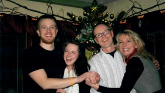 Ethan Monson-Dupuis (far left) poses for a family photo with his sister, Deva, and parents Jeff and Robin.