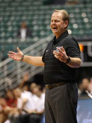 Head coach Kermit Davis of the Middle Tennessee Blue Raiders reacts to a call by the officials during the first half of the semi-final game of the Diamond Head Classic against the USC Trojans.