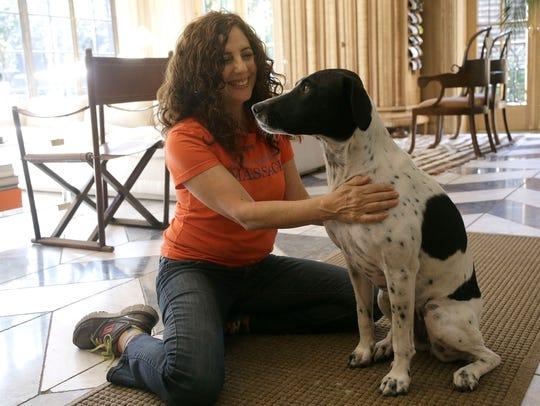 Shelah Barr of Happy Hounds Massage gives Dewie a massage