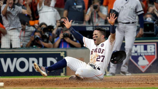 Oct. 14: Houston Astros second baseman Jose Altuve (27) celebrates as he scores the winning run in the bottom of the ninth of Game 2 of the ALCS against the New York Yankees.