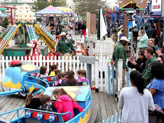 Parents watch as kids enjoy the rides in Kiddie Land