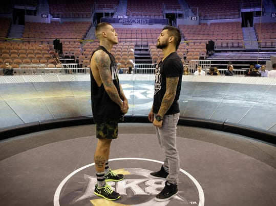 In this Aug. 14, 2014, photo, boxers Bryan Vera, right, and Gabrial Rosado pose for photographers inside of a Big Knockout Boxing ring  in Las Vegas. The two fighters are scheduled to be the main event of the Big Knockout Boxing event Saturday at the Mandalay Bay where they will fight in a 17-foot diameter round ring instead of a traditional boxing ring. (AP Photo/John Locher)