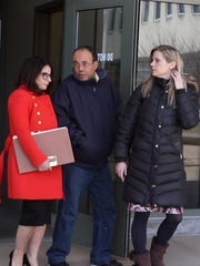 Eufracio Torres, father of Abigail Hernandez, leaves court with his daughter's attorney, on the right, Emily Rosmus.
