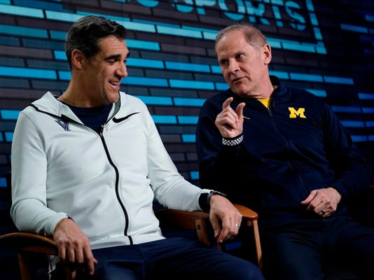 "Villanova head coach Jay Wright, left, and Michigan head coach John Beilein answer questions during an interview for CBS Sports Network's ""We Need to Talk"" show before the championship game of the Final Four NCAA college basketball tournament, Sunday, April 1, 2018, in San Antonio. (AP Photo/David J. Phillip)"