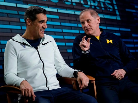 """Villanova head coach Jay Wright, left, and Michigan head coach John Beilein answer questions during an interview for CBS Sports Network's """"We Need to Talk"""" show before the championship game of the Final Four NCAA college basketball tournament, Sunday, April 1, 2018, in San Antonio. (AP Photo/David J. Phillip)"""