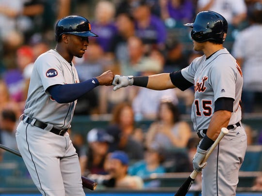 Tigers leftfielder Justin Upton is congratulated by teammate Mikie Mahtook after scoring during the first inning on Monday, Aug. 28, 2017, in Denver.