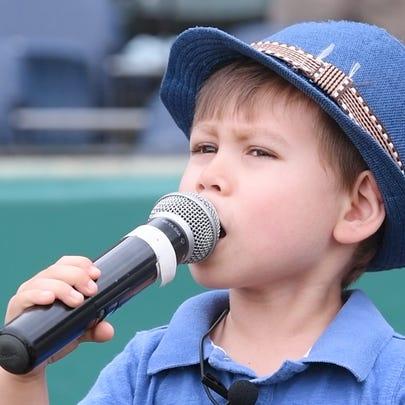 Landon Mak sings the National Anthem Sunday before