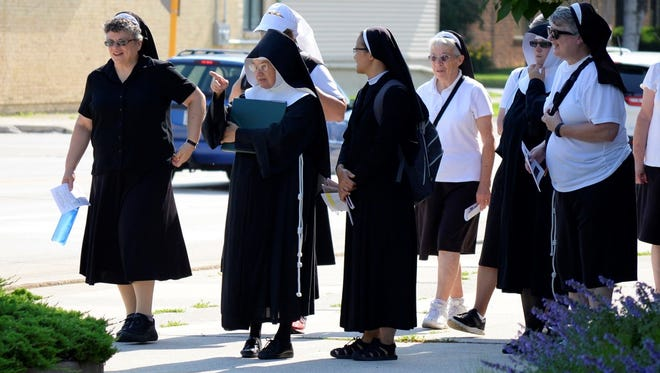 Sister Caritas, as Mother Gabriel, pointing out the historic heritage sites to the FSCC Pilgrims. Pilgrims: Sister Anne Turba, Sister Caritas, Sister Huong – Vietnamese Sister, Sister Leonette Kochan, Sister Clare Rose, as Sister Patricia Doyle, and Sister Linda Brandes.
