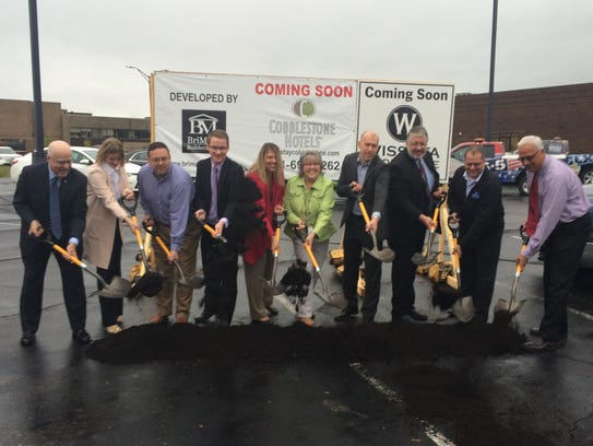 Local officials take part in a groundbreaking ceremony