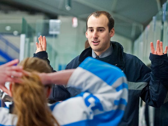 South Burlington girls hockey coach Jake Orr directs his team against Rice Memorial in South Burlington on Thursday, December 11, 2014.
