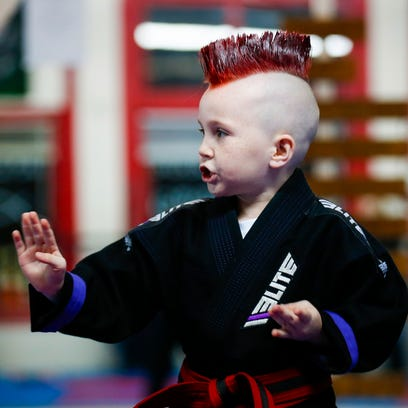 Six-year-old Lucas Glover practices his taekwondo forms