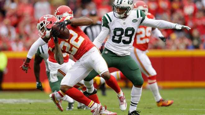 Chiefs cornerback Marcus Peters intercepts a pass in front of wide receiver Jalin Marshall of the New York Jets on Sunday.