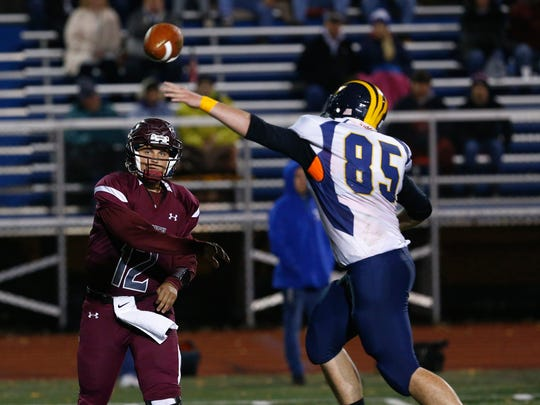 Tioga's Jacob Armstrong reaches for the ball passed by Sidney's Darren Smith during the Section 4 Class D final held at Binghamton Alumni Stadium on Friday, November 3, 2017.