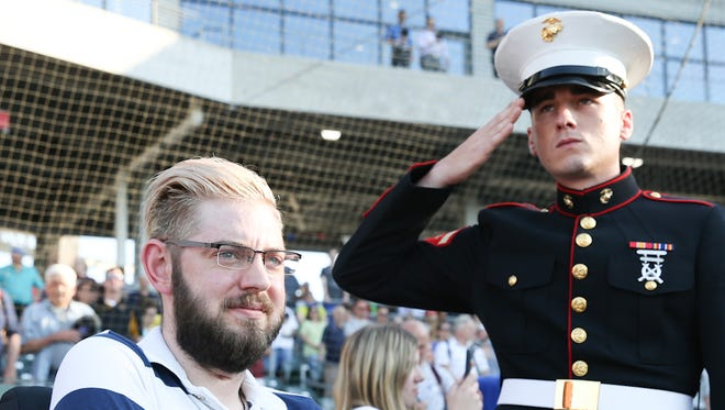 This first pitch isn't about baseball. It's about a military hero regaining his sense of independence.