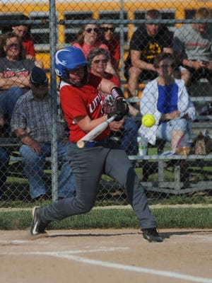 Union County's Tara Williams swings at a pitch against Knightstown during the sectional championship game Wednesday, May 25, 2016.