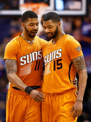 Phoenix Suns' Markieff Morris (11) congratulates his brother (15) Marcus Morris, who scored 34 points against the Utah Jazz during an NBA game on Friday, Feb. 6, 2015, in Phoenix.