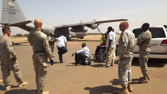U.S. soldiers stand guard as they prepare to evacuate U.S. citizens from South Sudan.