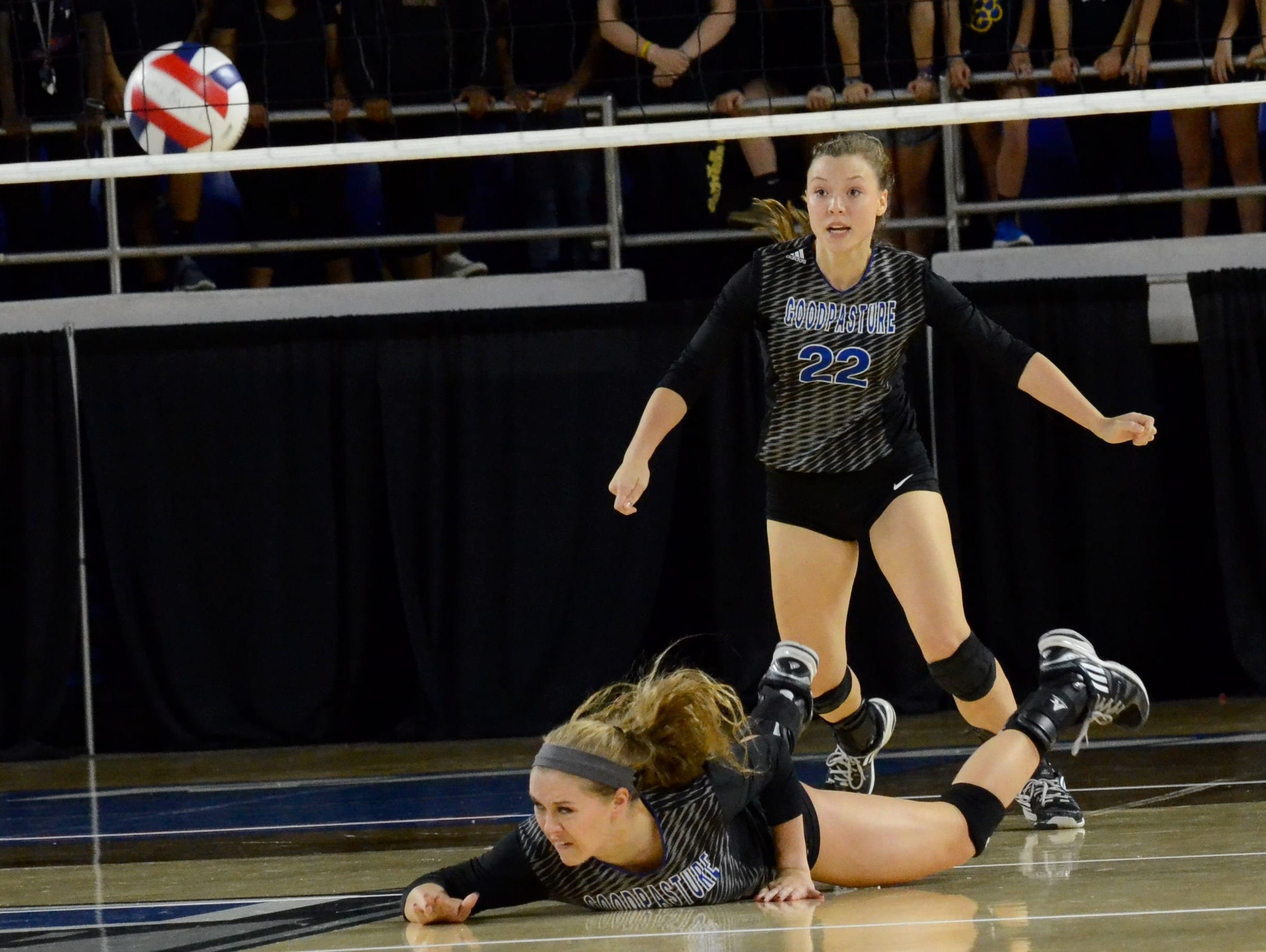 Goodpasture's Jennifer Rochelle dives to dig out a South Greene shot as Tatum Fox (22) looks on during Friday's Class A championship at MTSU.