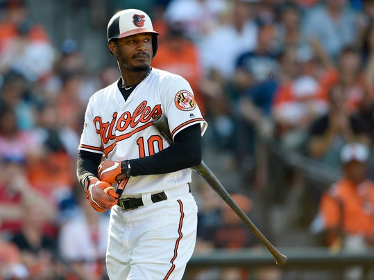 FILE - In this Sept. 4, 2017, file photo, Baltimore Orioles' Adam Jones walks back to the dugout after batting during a baseball game against the New York Yankees in Baltimore. For several years now, the Orioles have operated under manager Buck Showalter with a core group of players led by Manny Machado, Adam Jones and Zach Britton.  (AP Photo/Nick Wass, File)