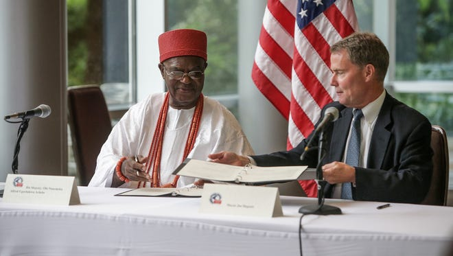 Indianapolis Mayor Joe Hogsett and Nnaemeka Alfred Achebe sign an agreement for a sister-city relationship with Onitsha, Nigeria, at the Indianapolis Museum of Art on Friday, June 23, 2017.