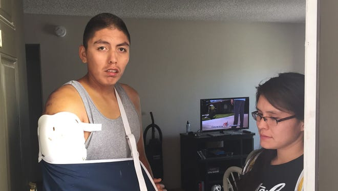 Donovan Worker, 24, stands next to his girlfriend, Calisha Nez, 24, at their Mesa apartment on Tuesday, March 24.