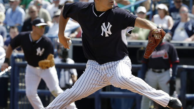 Yankees starting pitcher Masahiro Tanaka delivers in the third inning against the Atlanta Braves in an exhibition game in Tampa, Fla., on Sunday.