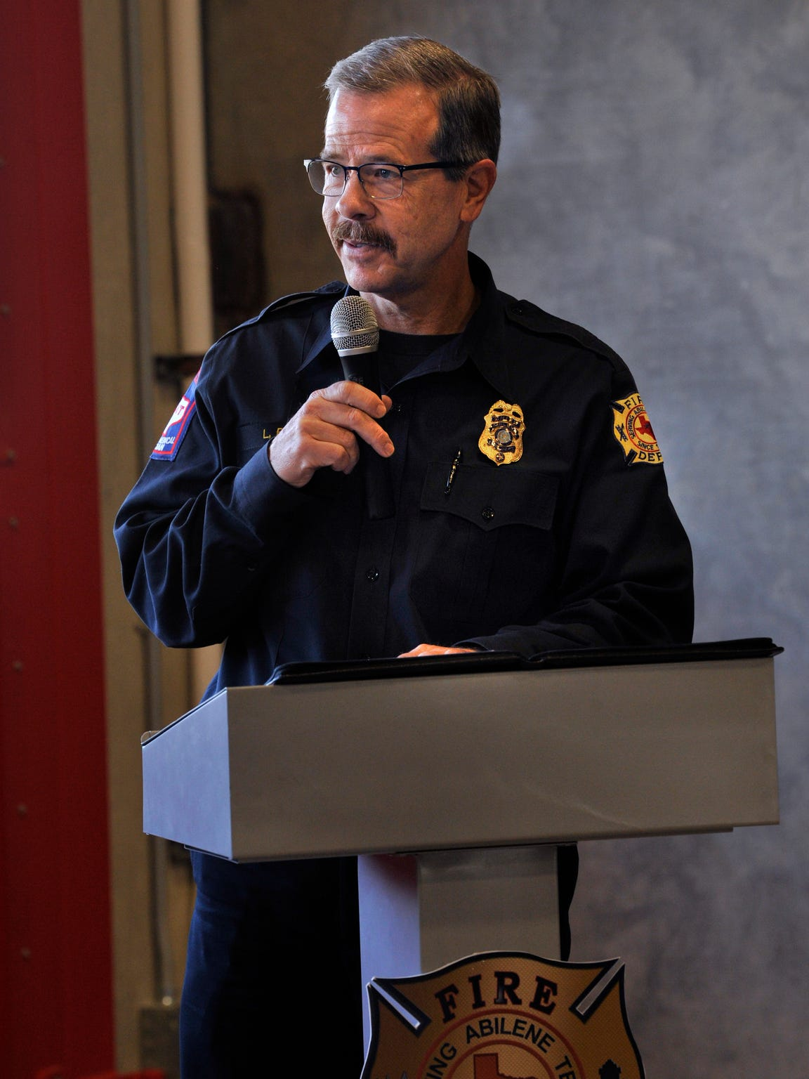 Abilene Fire Department Chief Larry Bell speaks during the dedication of the new Station 7 Friday. During the event, Bell announced he will retire May 31.