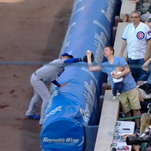 Keith Hartley makes an improbable — and foolish — catch while holding his 7-month-old during a game at Wrigley Field on Tuesday night.