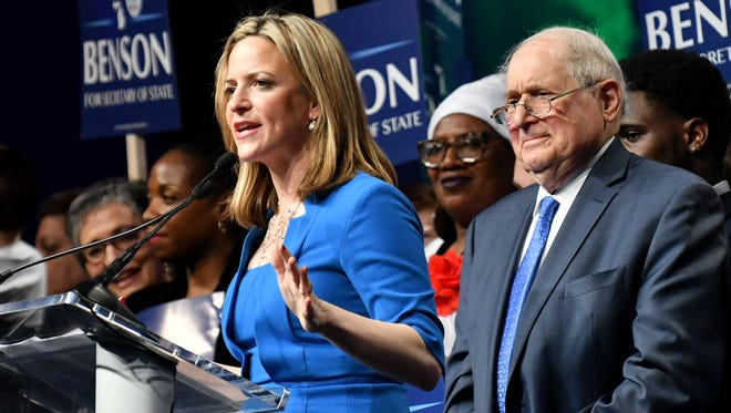 Secretary of State candidate Jocelyn Benson, left, speaks at the Michigan Democratic convention at Cobo Center in Detroit on April 15, 2018. Behind her is former U.S. Sen. Carl Levin, right.