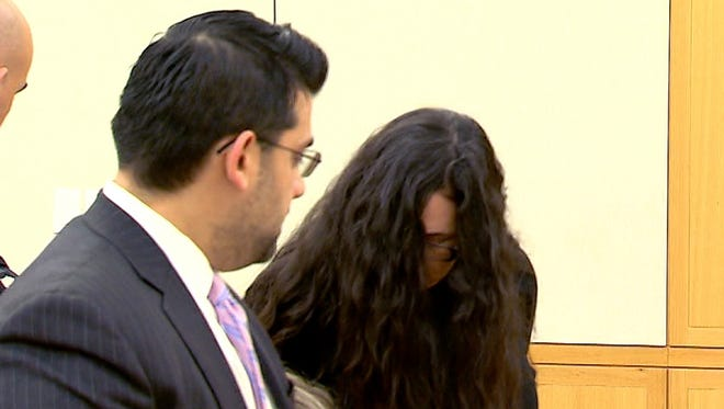 """Manuela Maria Morgado is shown at Westchester County Court in White Plains Dec. 5, 2014, with her attorney Saad Siddiqui. She was sentenced to 20 years to life in the smothering death of her 4-year-old son, Jason """"Jake"""" Reish."""
