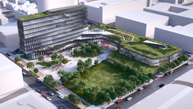This is a rendering of the headquarters for Cummins' Global Distribution Business being constructed in Downtown Indianapolis. Cummins says the $30 million, 10-story office tower with green space at the site of the former Market Square Arena will open in late 2016.