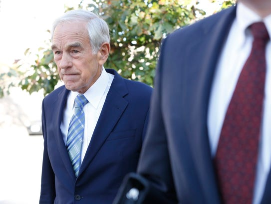 Former Republican presidential candidate Ron Paul (left)